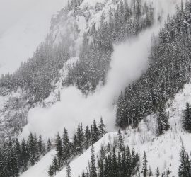 avalanche rolling down the mountain