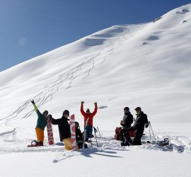 ski touring group of happy skiers